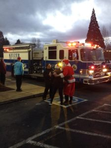 The Keizer Fire District Santa was on site to welcome runners to the start line. - Photo by Matt Rasmussen