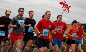 You're likely to spot the Red Lizard logo held by a pacer at the Portland Marathon.