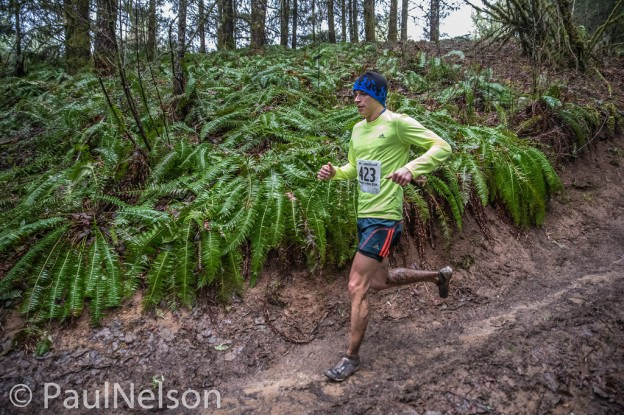 Brian Bernier on one of the slick, muddy downhills at the 2014 ORRC Hagg Mud 25k. Credit: Paul Nelson Photography
