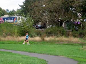 Runners on the Fanno Creek Trail, near the underpass below Scholls Ferry Road.