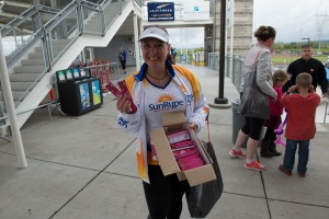 Maryalicia poses with her full box of SunRype before they are gone after  the Hippie Chick Half Marathon