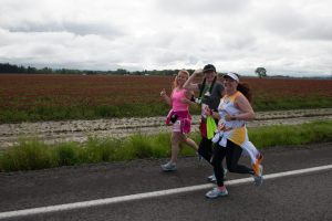 Kim, Robin, and Maryalicia and Robin at mile 5 of the Hippie Chick Half Marathon